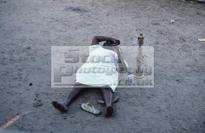 laid-back laid back laidback man lying smoking hookah pipe railway line kosti station sudan. breakdowns trains days late. tobacco contains bango marijuana indiginous people african travel cannabis dope drugs sudan africa sudanese