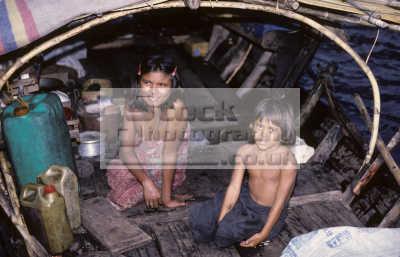 moken children known saleeter salon salone morgan sea gypsies mergui archipelago thailand living traditional life boat sea. koh surin nua north island come ashore monsoon. indiginous people asian travel asia thai
