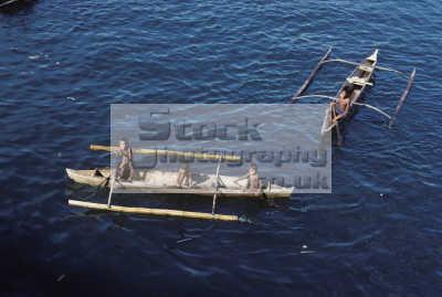 badjao tau-laut tau laut taulaut sea gypsies young boys outrigger canoes isabela harbour basilan strait island mindanao philippines. indiginous people asian travel phillipines pacific oceanic oceans philippines philippino