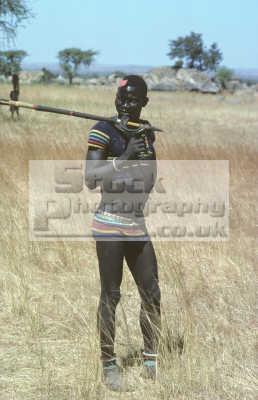 nuba stick wrestler warrior matching wool twinset despite 100 humidity high ambient temperature. south kadugli mountains kordofan sudan indiginous people african travel africa sudanese