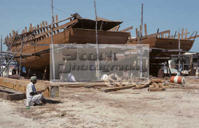 constructing dhows man using adze shape main keel dhow hamriya harbour dubai united arab emirates. asian industry industrial travel middle east kingdom british