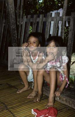 young children mompilis longhouse rungus tribe kadazan people near kudat sabah. borneo malaysia. indiginous asian travel malaysia asia malaysian