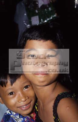 boy girl bajau tribe muslim icebox water village tawau sabah. borneo malaysia. indiginous people asian travel family islam malaysia asia malaysian