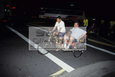 trishaw tricycle rickshaw tourist passenger north bridge road singapore asian industry industrial travel asia