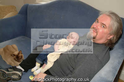 dad sleeping baby cat anthony boys male child males masculine manlike manly manful virile mannish people persons portraits united kingdom british