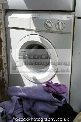 washing machine pile kitchens cooking interiors inside british housing houses homes dwellings abode architecture architectural buildings uk domestic united kingdom
