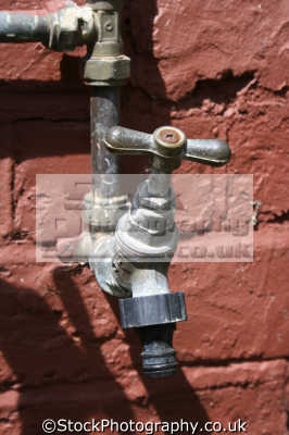 outside tap british housing houses homes dwellings abode architecture architectural buildings uk plumbing water united kingdom