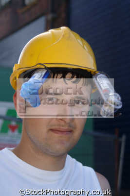 construction worker novel cooling fans hardhat labour working people persons cheshire england english angleterre inghilterra inglaterra united kingdom british