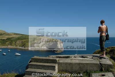 woman photographer lulworth cove uk coastline coastal environmental dorset england english great britain united kingdom british