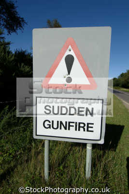 sign saying sudden gunfire pockmarked bullet holes near lulworth army firing range allegory abstracts misc. dorset england english great britain united kingdom british