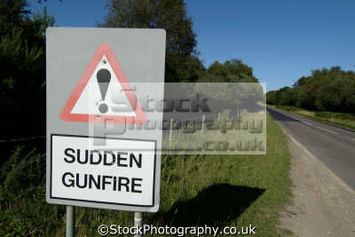 sign saying sudden gunfire pockmarked bullet holes near lulworth army firing range allegory abstracts misc. shooting shots dorset england english great britain united kingdom british