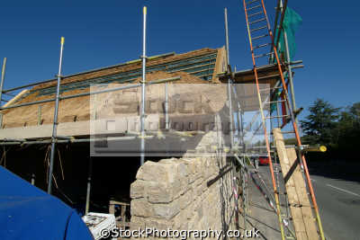 thatched roofing work progress showing thatch roof houses british housing homes dwellings abode architecture architectural buildings uk roofers builders dorset england english great britain united kingdom