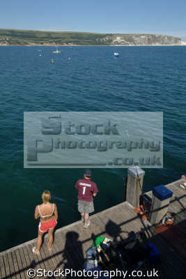 couple sea fishing piers uk coastline coastal environmental swanage purbeck dorset england english great britain united kingdom british
