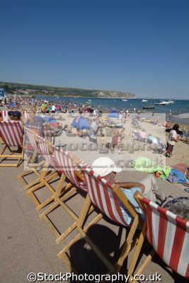 swanage deck chairs promenade british beaches coastal coastline shoreline uk environmental purbeck dorset england english great britain united kingdom