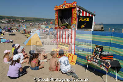punch judy british beaches coastal coastline shoreline uk environmental domestic violence swanage purbeck dorset england english great britain united kingdom