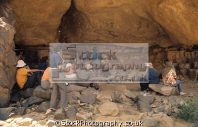 group sitting shade admire rock frescoes paintings tanzoumaitak tassili ajjer plateau djanet central sahara desert algeria africa african archeology archeological travel algerian