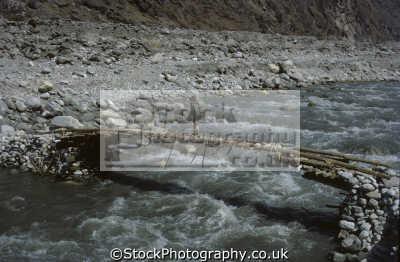 trekker crossing narrow footbridge modi khola river annapurna region himalayas nepal asian travel asia nepalese