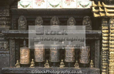brass prayer wheels figurines buddha swayambhunath temple hilltop west kathmandu nepal. contain prayers clockwise revolution considered uttered mantra asian travel nepal asia nepalese