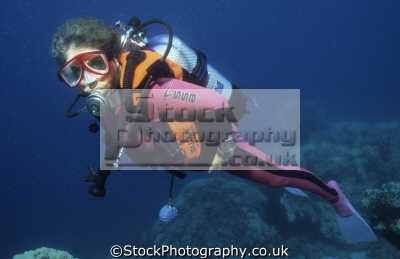 diver babs jackson wearing modern diving equipment. fins mask lycra suit buoyancy compensator device bcd colour-coordinated colour coordinated colourcoordinated sw point sanganeb sudan red sea. indian ocean women underwater divers people scuba marine africa sudanese
