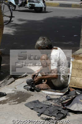 street cobbler repairing sandals india indian people asian travel asia