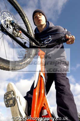 cycle trials rider extreme sports adrenaline sporting uk bmx youth white caucasian portraits united kingdom british