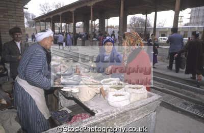 women shopping stall spice seller kolhoznaya covered bazaar samarkand uzbekistan indiginous people asian travel asia uzbekistani