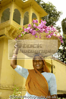 smiling indian woman carrying basket head people asian travel india asia
