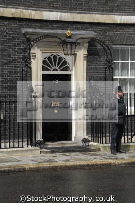 policeman outside 10 downing street home british prime minister famous streets london capital england english uk government westminster cockney great britain united kingdom