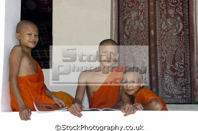 young buddhist monks laos religion worship faith religious belief working people persons buddhism orange god holy asia lao democratic republic laotian