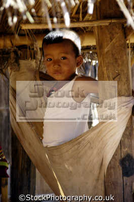 young boy paduang hill tribe people thailand long neck indiginous asian travel asia thai