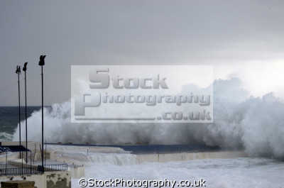 storm waves malta harbour. european travel extreme weather floods maltese europe