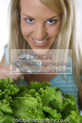 food hygiene. girl magnifying glass looking lettuce healthy eating nutrition balanced diet human activities people persons