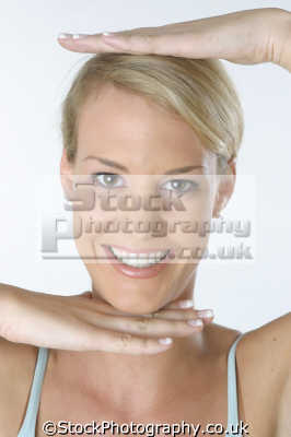 brown eyed blonde girl hands posed facial expressions emotions emotional nonverbal communication body language people persons teeth oral