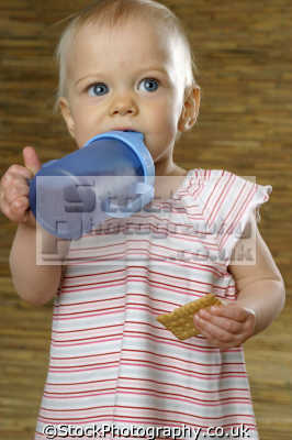 baby girl beaker biscuit people drinking eating nutrition human activities persons