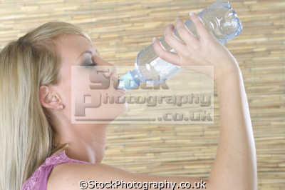 woman drinking bottled water people eating nutrition human activities persons