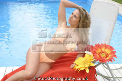 model sunlounger pool bikini models swimwear swimsuits female sexuality sexually attractive attraction women woman females feminine womanlike womanly womanish effeminate ladylike people persons