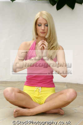young blonde woman yoga position enlightenment. karma bhakti jnana raja hatha relaxation posture physical exercise athletic aerobic anaerobic health fitness people persons