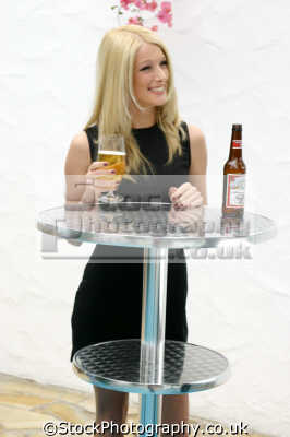 young blonde woman drinking lager beer alchohol people eating nutrition human activities persons binge