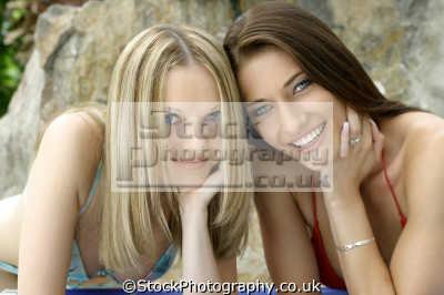 blonde brunette smiling women woman female females feminine womanlike womanly womanish effeminate ladylike people persons