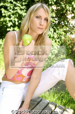 woman eating apple healthy nutrition balanced diet human activities people persons