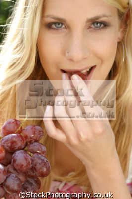 sensual woman eating grape healthy nutrition balanced diet human activities people persons