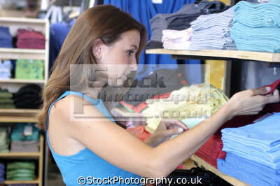 woman shopping t-shirts t shirts tshirts retail purchase human activities people persons