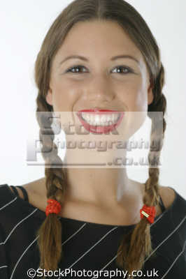 woman pigtails smiles facial expression pleasure amusement smiling faces visage people persons
