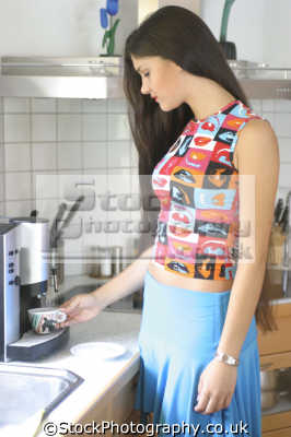 woman coffee machine women cooking cookery cuisine meals housework domestic chores working people persons