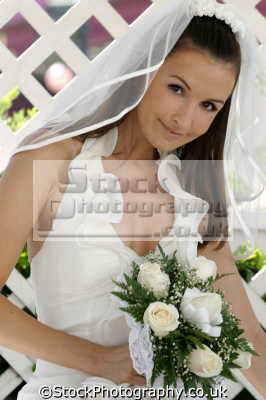 sexy bride holding bouquet flowers married couples marriage monogamous monogamy husband wife boyfriend girlfriend spouse families family kin kinfolk tribe generations geneaology people persons