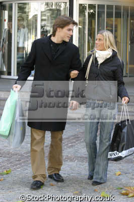 couple shopping winter clothes going entertainment enjoyment human activities people persons