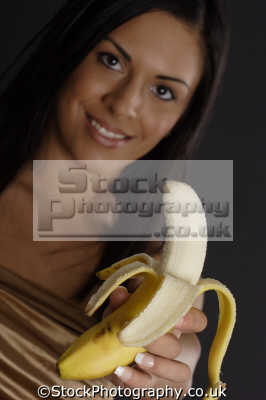 banana woman eating nutrition human activities people persons