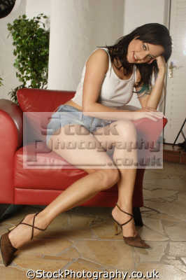 leggy brunette leather chair brunettes pigment eumela brown colour color women woman female females feminine womanlike womanly womanish effeminate ladylike people persons mini skirt