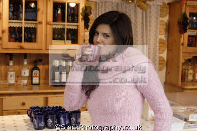middle aged woman pink sweater drinking mug tea coffee people eating nutrition human activities persons beverage