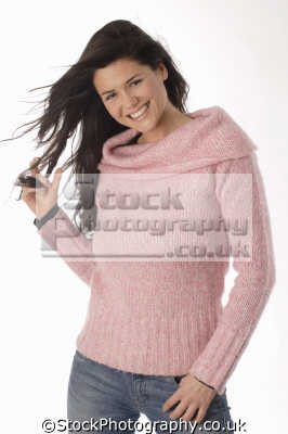 middle aged woman pink sweater drinking playing hair fashion haute couture chic designer people persons